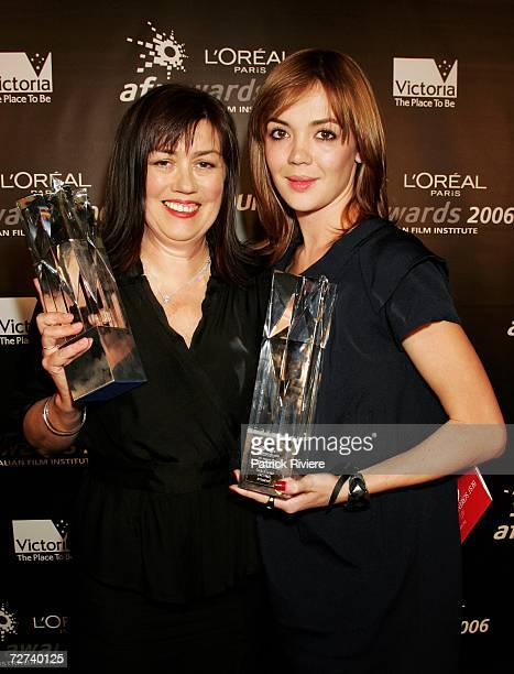 Scriptwriter Kathleen O'Brien poses in the awards room with the award for Best Screenplay in a Short Film and Emma Lung poses with the award for...