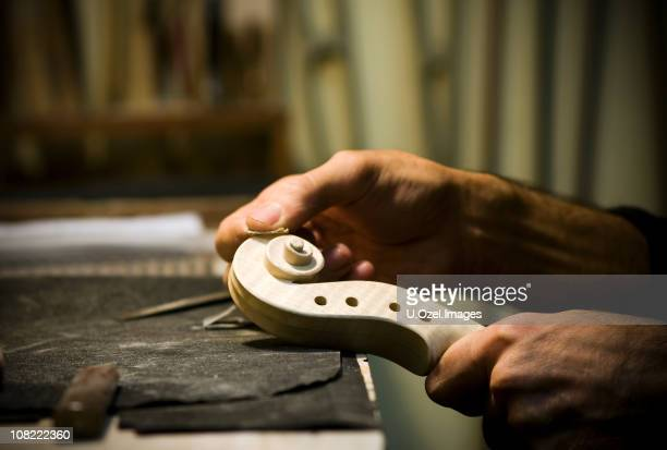 scroll part of a violin... - instrument maker stock photos and pictures