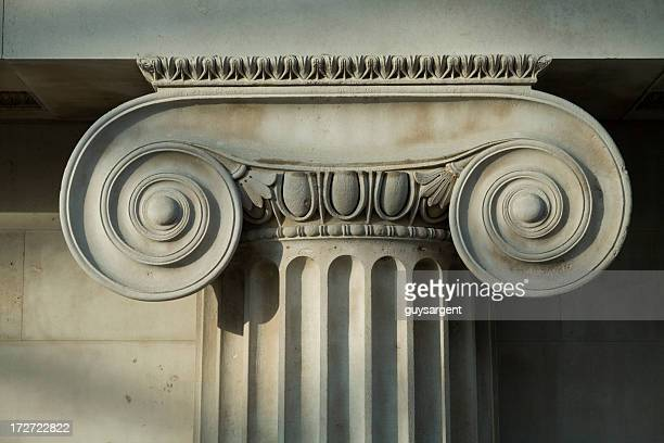scrolled stone column. - architectural column stock pictures, royalty-free photos & images