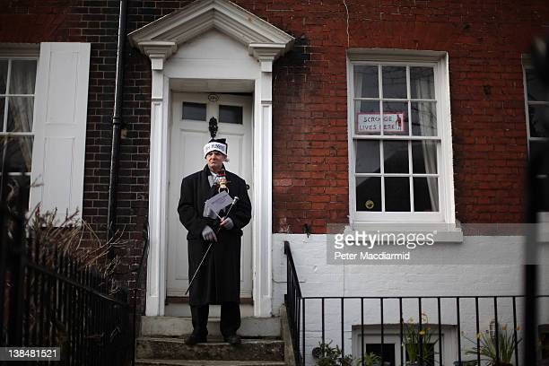 Scrooge fan David James stands outside his house which is three doors away from Charles Dickens' birthplace on February 7 2012 in Portsmouth England...