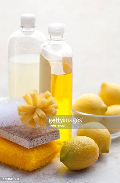 Scrubber, sponges, cleaning soap and lemons