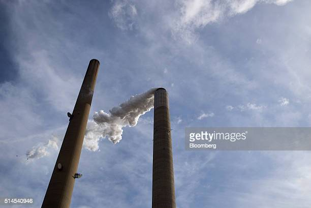 A scrubber stack releases water vapor at the American Electric Power Mountaineer coal plant in Letart West Virginia US on March 9 2016 US industrial...