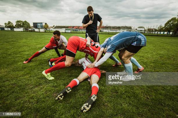 scrum action on rugby match! - sports official stock pictures, royalty-free photos & images