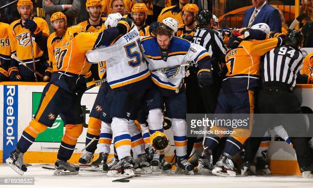 A scrum between the Nashville Predators and the St Louis Blues occurs during the third period of Game Four of the Western Conference Second Round...