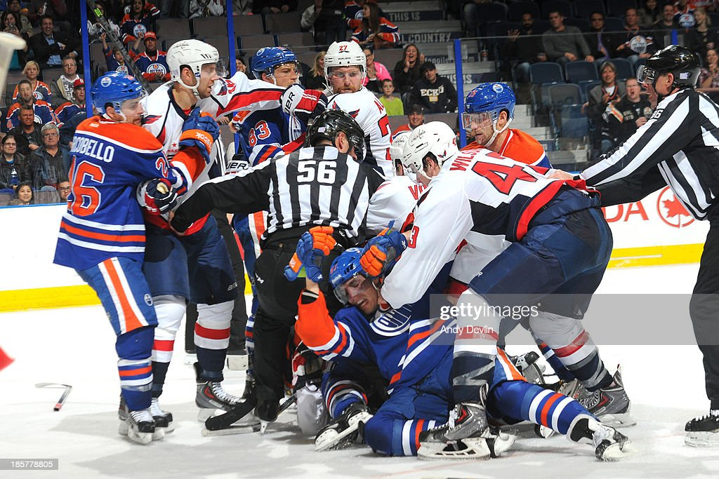 A scrum ensues in front of the net in a game between the Edmonton Oilers and the Washington Capitals on October 24, 2013 at Rexall Place in Edmonton, Alberta, Canada.