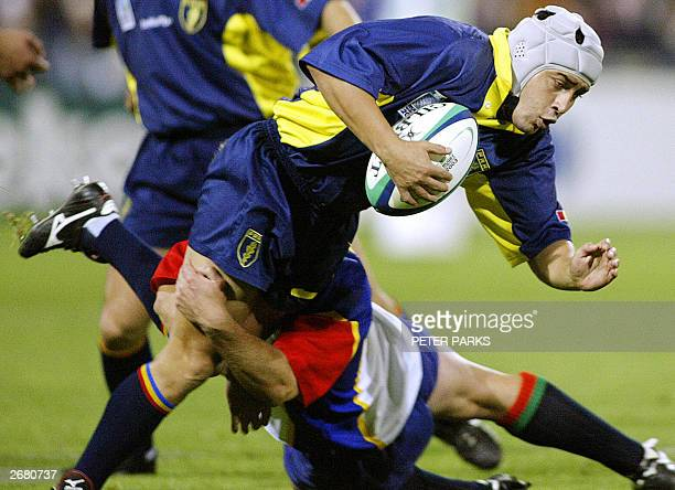 scrumhalf Iulian Andrei of Romania is tackled by flyhalf Emile Wessels of Namibia at York Stadium in Launceston in their last Pool A game of the...