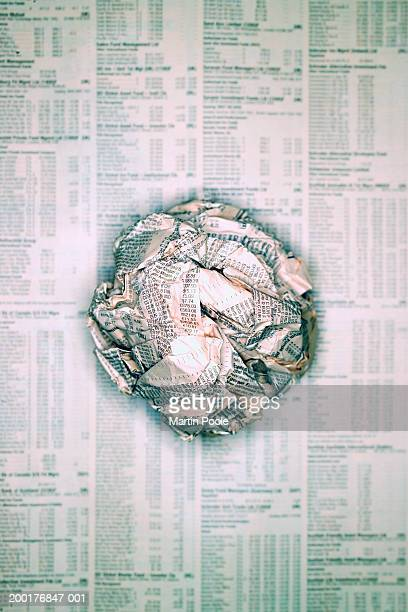 Scrunched ball of newspaper on flat page of newspaper