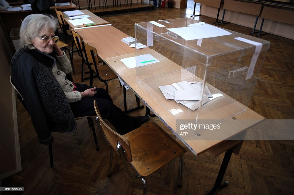 A scrutineer looks at a ballot box at a polling station during the national referendum in the town of Sofia on January 27, 2013. Bulgarians voted Sunday on whether to revive plans ditched by the government to construct a second nuclear power plant, in the EU member's first referendum since communism. The referendum asks 6.9 million eligible voters: 'Should Bulgaria develop nuclear energy by constructing a new nuclear power plant?'