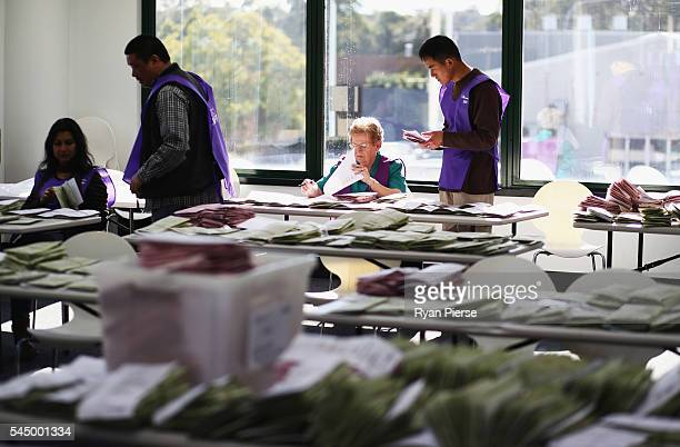 Scrutineers count postal votes at the Gordon counting centre in on July 5 2016 in Sydney Australia Counting continues after election night on...