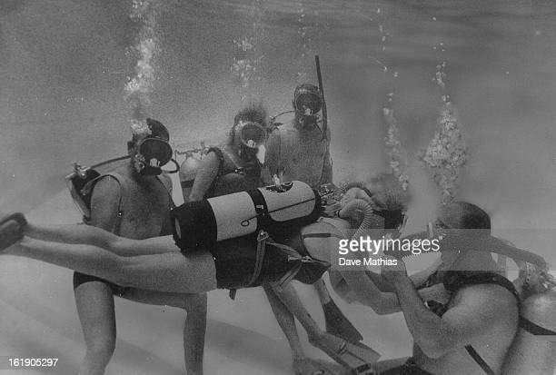 JAN 21 1965 JAN 27 1965 Scuba buddies Share To Spare a Life nstructor Jim Smith right tests Mrs Robert Horecky on buddy breathing techniques in...