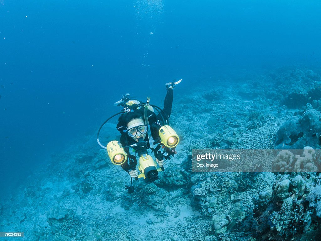 Scuba diver and camera : Stock Photo