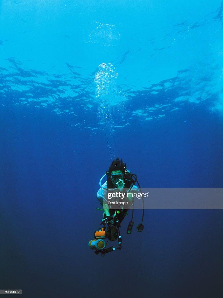 Scuba diver and camera : Stock Photo