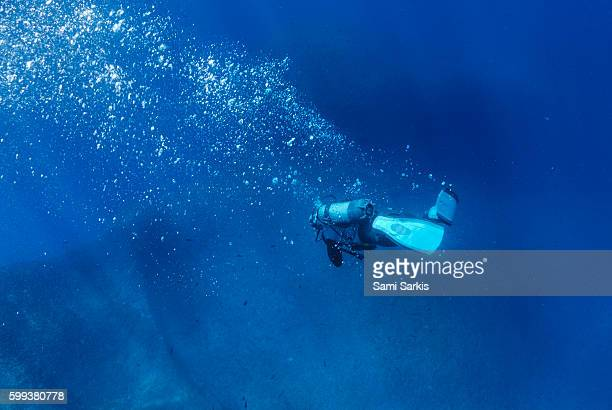 Scuba diver by a shipwreck underwater, Mediterranean Sea, France, Europe