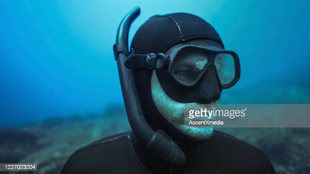 scuba diver explores underwater reefs - aqualung diving equipment stock pictures, royalty-free photos & images