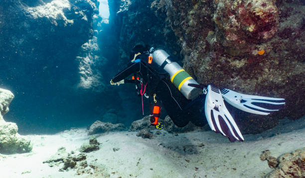 scuba diver exploring a canyon at the great barrier reef in Australia