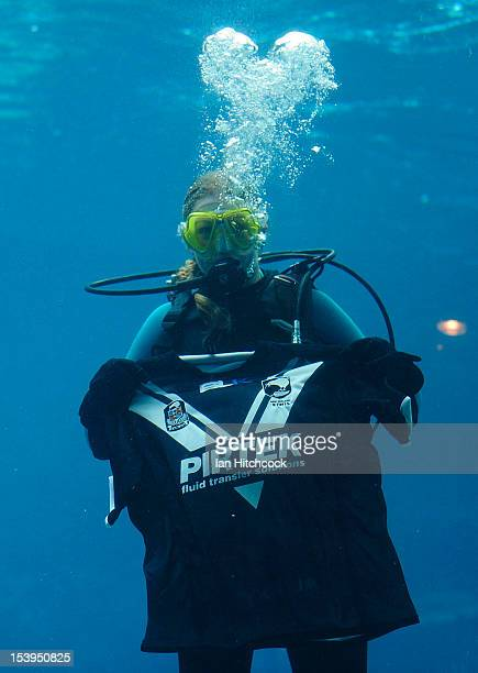 Scuba Diver from 'Reef HQ Aquarium' holds up a New Zealand jersey before a press conference ahead of tomorrow night's International Test match...