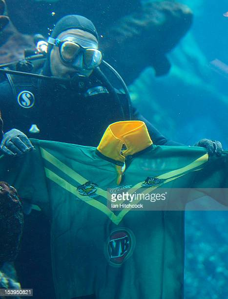 Scuba Diver from 'Reef HQ Aquarium' holds up an Australian jersey before a press conference ahead of tomorrow night's International Test match...