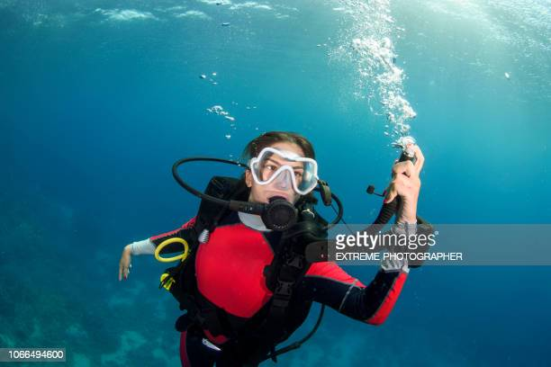 scuba diver girl descending - bottomless girl stock pictures, royalty-free photos & images