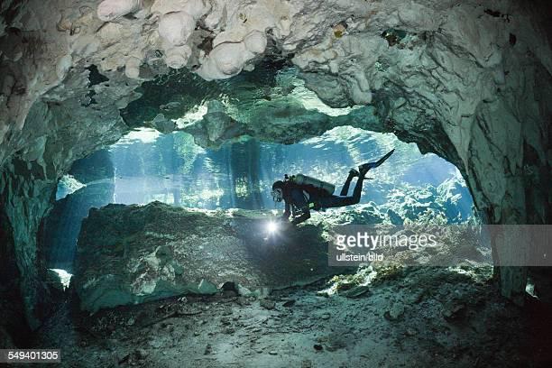 Scuba Diver in Gran Cenote Tulum Yucatan Peninsula Mexico