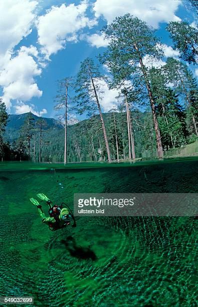 Scuba diver in mountain lake, Austria, Tirol