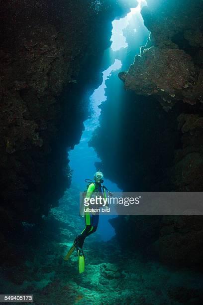 Scuba Diver in Underwater Cave Namena Marine Reserve Fiji