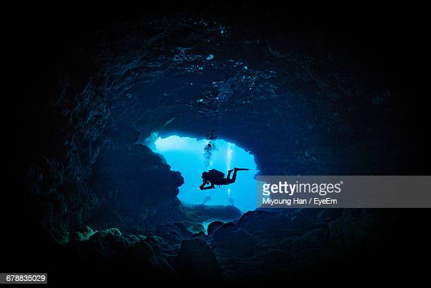 scuba diver in underwater cave - scuba diving stock pictures, royalty-free photos & images
