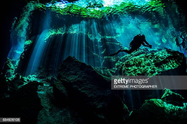 scuba diver in underwater caves - quintana roo stock pictures, royalty-free photos & images