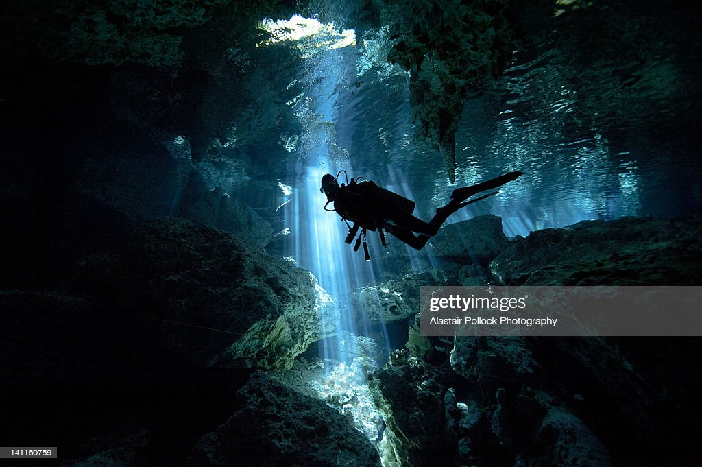 Scuba diver inside cenote in Mexico : Stock Photo