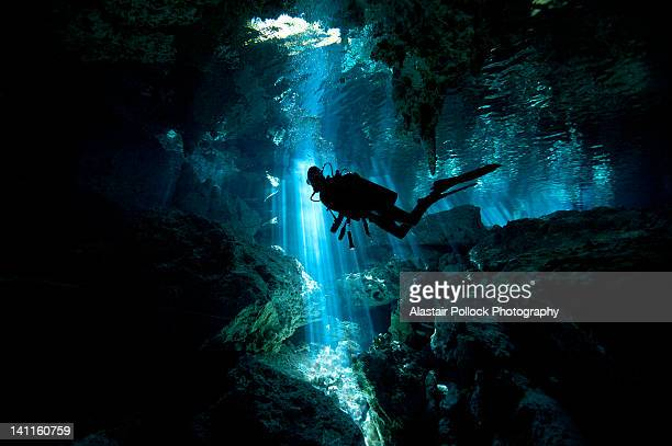 scuba diver inside cenote in mexico - quintana roo stock pictures, royalty-free photos & images