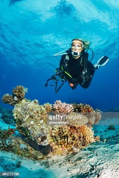 Scuba diver is exploring and enjoying Coral reef  Sea life  Sporting women Underwater photographer