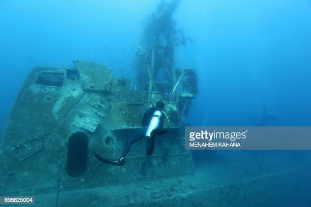 A scuba diver is seen next to the wreck of a ship in the Red Sea off the southern Israeli resort city of Eilat on June 12 2017 Global warming has in...