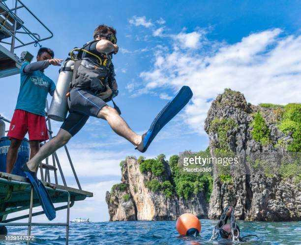 Scuba Diver jumping off boat demonstrating perfect giant stride entry