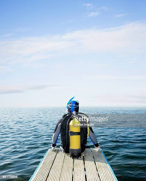 Scuba diver looking out to sea