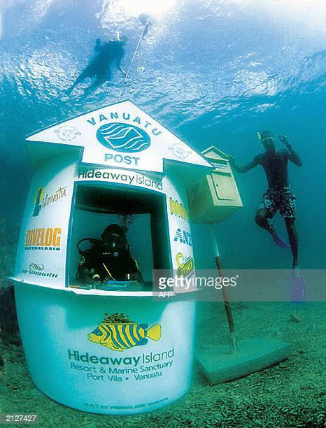 A scuba diver mans the world's first underwater post office as a snorkeller uses the aquatic post box off the coast of Hideaway Island in Vanuatu 30...