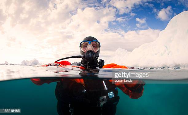 Scuba diver next to an iceberg - split shot