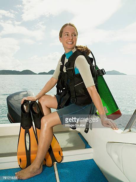 scuba diver on a boat - aqualung diving equipment stock pictures, royalty-free photos & images