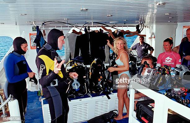 Scuba diver prepares equipment Egypt Red Sea St John's Reef Royal Evolution