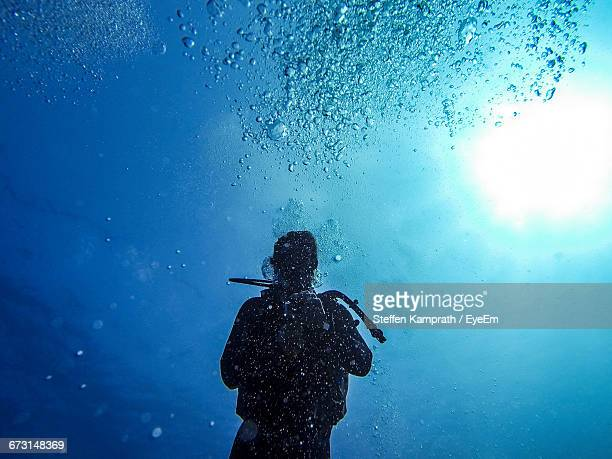 Scuba Diver Swimming In Sea