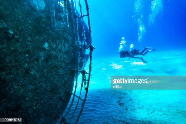 scuba divers at wreck diving - sunken stock pictures, royalty-free photos & images