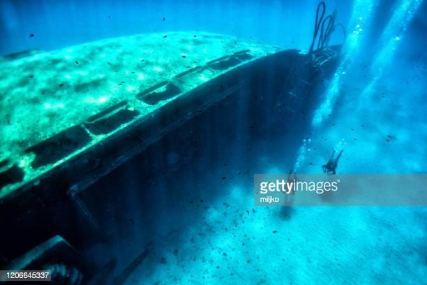 scuba divers at wreck diving - miljko stock pictures, royalty-free photos & images