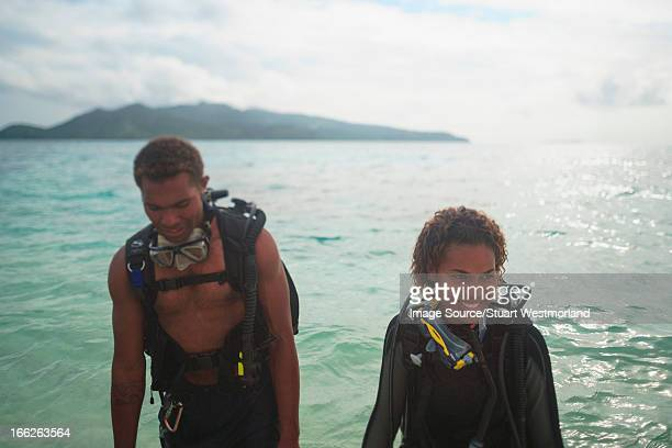 Scuba divers in tropical water