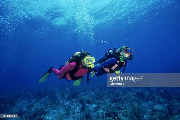 scuba divers over shallow reefs , caribbean - scuba diving stock pictures, royalty-free photos & images