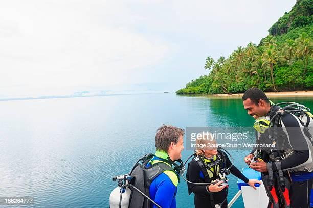 Scuba divers talking on boat