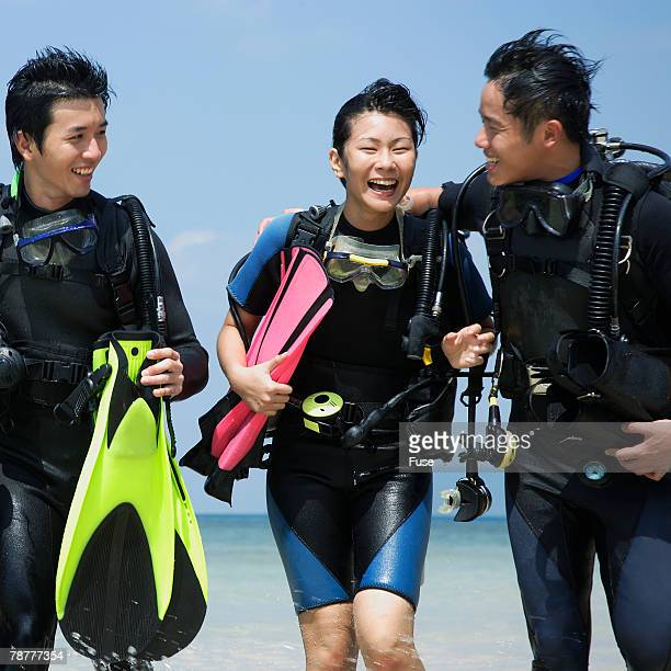 Scuba Divers Wading Back to Shore