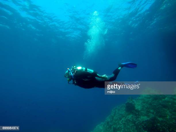 scuba diving - diving into water stock photos and pictures