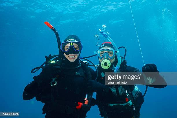 Scuba diving    Underwater scene with two scuba diver in blue