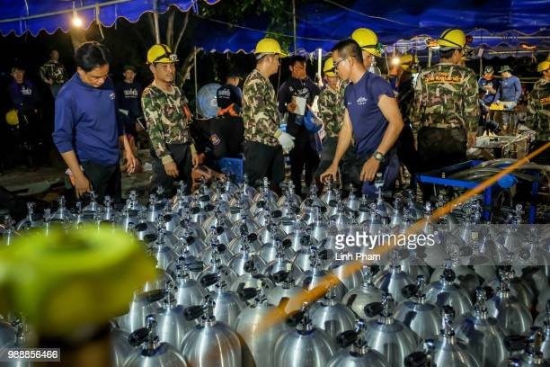 Scuba tanks are delivered to the site for Thai navy SEAL on July 01 2018 in Chiang Rai Thailand Rescuers in northern Thailand looked for alternative...
