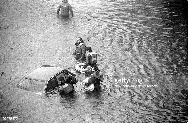 Scuba team goes to the rescue of motorists in flooded northbound lane of the FDR Drive at 80th St