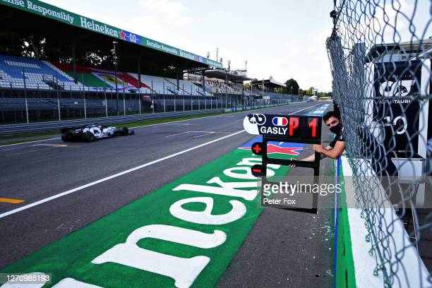 Scuderia AlphaTauri team member holds a position board from the pit wall for Pierre Gasly of France and Scuderia AlphaTauri during the F1 Grand Prix...
