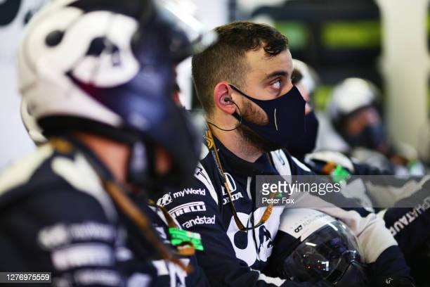 Scuderia AlphaTauri team members look on in the garage during the F1 Grand Prix of Russia at Sochi Autodrom on September 27 2020 in Sochi Russia